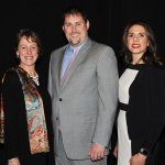 Tracy Monroe, representing Ronald McDonald House Charities of Greater Cincinnati, with honorees Richard and Brianna Ritz Credit: Paula Norton