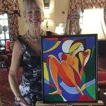 "Judy Bajus-Davis and her original painting of ""Unleash Your Sparkle"""