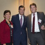 ReSource executive director Christie Brown, emcee Phil Castellini and honoree James Zimmerman of Taft
