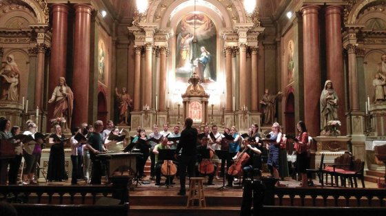 """Conductor Craig Hella Johnson leads VAE in a rehearsal of """"Canticle"""" in 2016."""