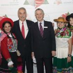 Alfonso Cornejo, president of the Hispanic Chamber Cincinnati, and Carlos Pareja, Peru's ambassador to the United States, with Peruvian women wearing attire of the Andes