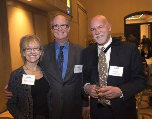 Nancy Frank, committee member, with event sponsors Steve Frank and Marty Greenwell