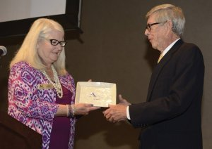 Assistance League President Nancy Purcell with keynote speaker Ed Adams