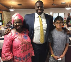 CYC alum and mentor Aliou Diouf (center) with his mom, Díe Dieng, and mentee Gabriel