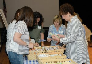 Wendy Pelberg and Sue Price fill snack bags.