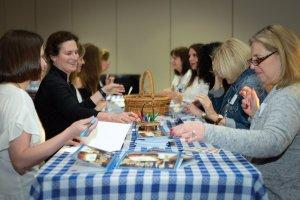 Jessica Kuresman, Amy Susskind Weiskopf and Debbie Steinbuch write cards for hospital patients.