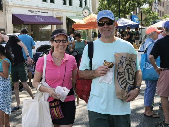 Liz Stites runs the Hyde Park Farmers' Market, and is seen here shopping with her husband, Kevin Randall. Stites helped out the management team for several years before joining the staff.