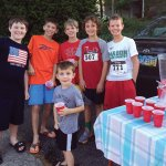 Finnegan McCarthy (far left), with friends, sold lemonade to raise funds for Cancer Support Community.