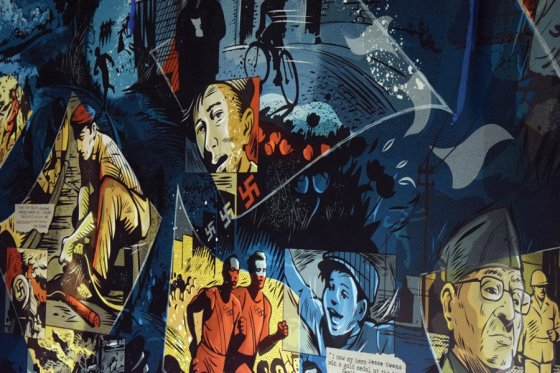 Detail of the lobby's 60-foot, graphic-novel-style mural, which features stories of WWII Holocaust liberators and survivors with local ties. The artist is Keith Neltner, who created 25 vignettes in all.