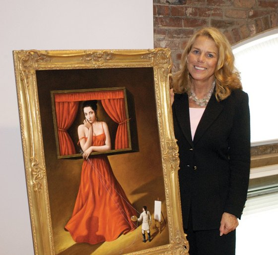 Patty Beggs with the promotional artwork for Cincinnati Opera's 1998 production of 'Tosca,' created  by artist Rafal Olbinski