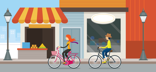 Couple Riding Bicycles In Town