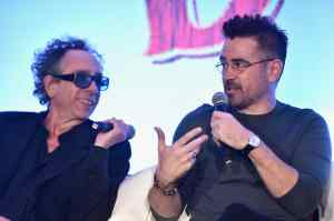 """Director/executive producer Tim Burton (L) and actor Colin Farrell speak onstage during the """"Dumbo"""" Global Press Conference at The Beverly Hilton Hotel on March 10, 2019 in Los Angeles, California. (Photo by Alberto E. Rodriguez/Getty Images for Disney) *** Local Caption *** Tim Burton; Colin Farrell"""