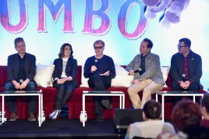 """BEVERLY HILLS, CA - MARCH 10: (L-R) Production Designer Rick Heinrichs, costume designer Colleen Atwood, composer Danny Elfman, screenwriter/producer Ehren Kruger and producer Justin Springer speak onstage during the """"Dumbo"""" Global Press Conference at The Beverly Hilton Hotel on March 10, 2019 in Los Angeles, California. (Photo by Alberto E. Rodriguez/Getty Images for Disney) *** Local Caption *** Rick Heinrichs; Colleen Atwood; Danny Elfman; Ehren Kruger; Justin Springer"""