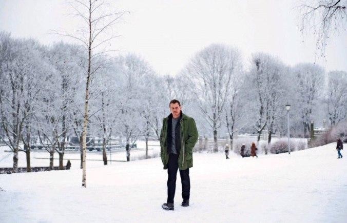 Michael Fassbender in The Snowman walking on snow