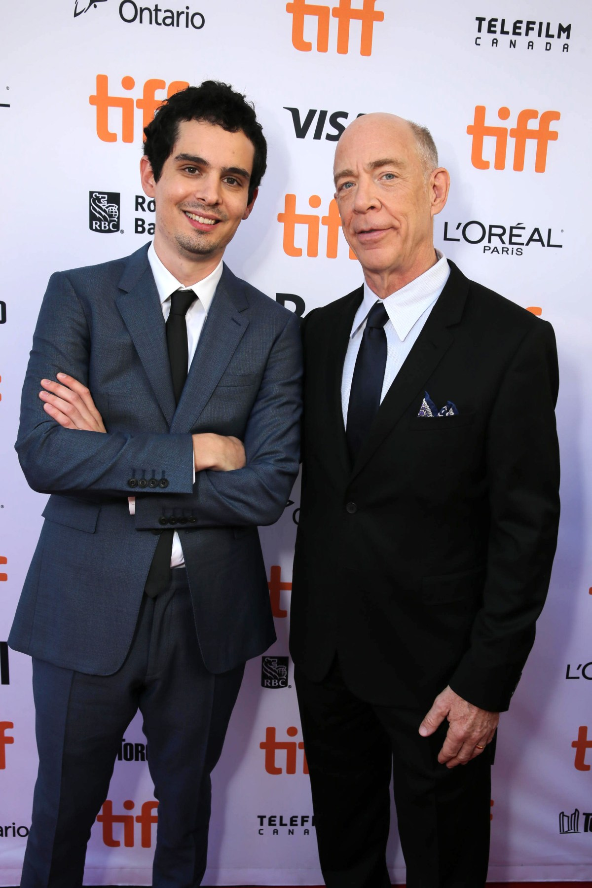 """Writer/Director Damien Chazelle and J.K. Simmons seen at Summit Entertainment's """"La La Land"""" premiere at the 2016 Toronto International Film Festival on Monday, Sept. 12, 2016, in Toronto. (Photo by Eric Charbonneau/Invision for LionsgateAP Images)"""