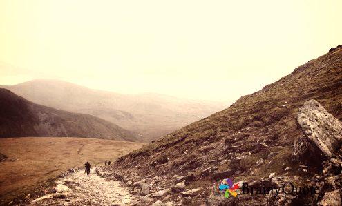 man on mountain trail