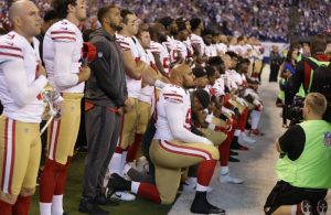 NFL team members kneeling in protest