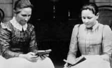 Two women reading, ca. 1903