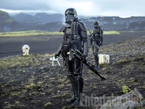 Toy Soldier In one of the more intriguing photos from Rogue One, we have this image of Deathtroopers prowling on a tundra. One of them is holding what appears to be … an action figure of sorts. The filmmakers didn't want to explain exactly what's happening here, but they confirm: yes, that's a Stormtrooper doll, a galactic version of a toy soldier. And it will have special significance in the story. (Decades later, an abandoned girl name Rey will also fashion a doll for herself — this one an X-wing pilot.)