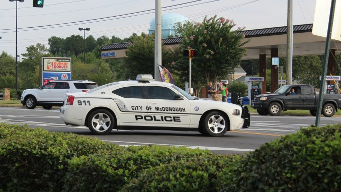 Photo of McDonough police car at the scene of an accident in August 2017 (staff photo)