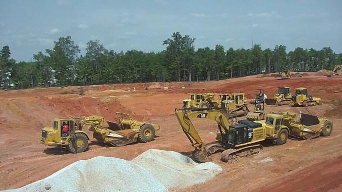 Photo of construction equipment at Station 75 Apartments (Avila Construction photo)