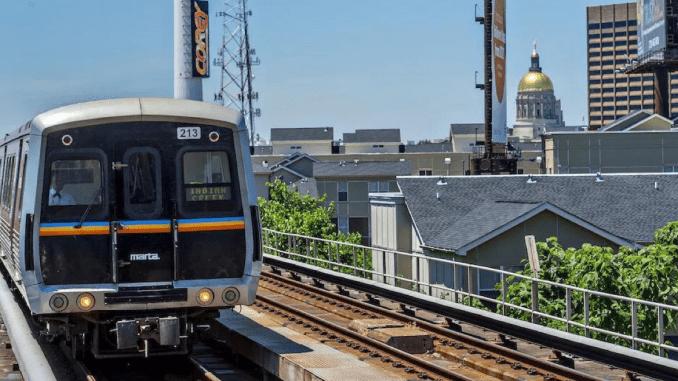 Photo of MARTA heavy-rail line with Georgia Capitol in background (Curbed Atlanta photo)
