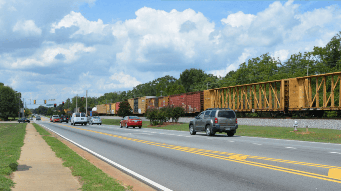 Photo of downtown Locust Grove with cargo train in the background (Atlanta Regional Commission photo)