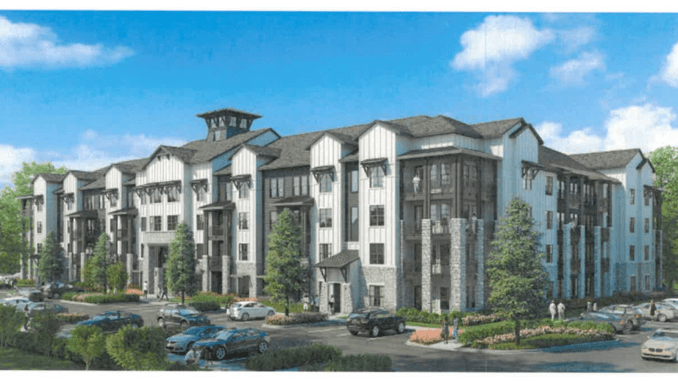 Photo shows a four-story apartment building. The building will be the main building at new apartments off Foster Drive in McDonough (Arlington Properties photo).