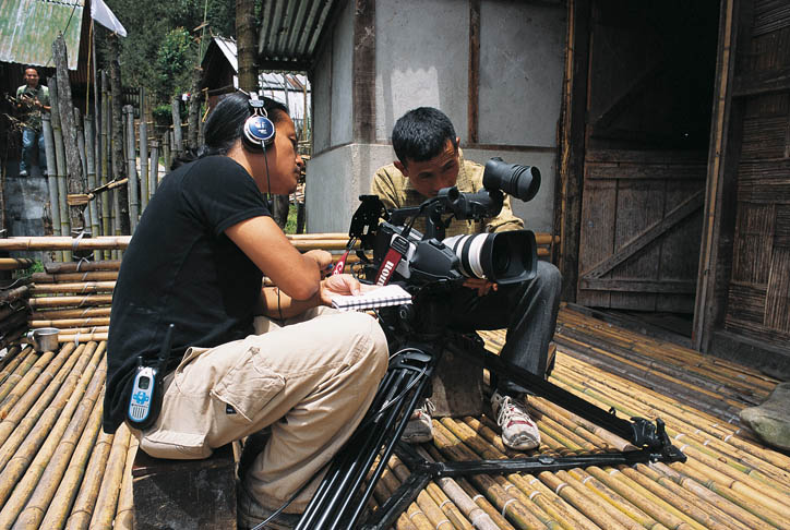 Riba teaches Hage Komo the basic camera skills that will allow the young Apatani to film an interview with his father and an animist priest, thus recording his tribe's oral history (Photo courtesy Rolex Awards)