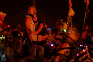 Participants watch The Temple burn as approximately 70,000 people from all over the world gathered for the annual Burning Man arts and music festival in the Black Rock Desert of Nevada