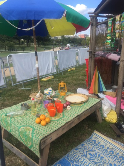 Table filled with food and wares for sale along the refugee route
