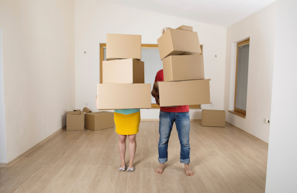 couple with stacks of boxes