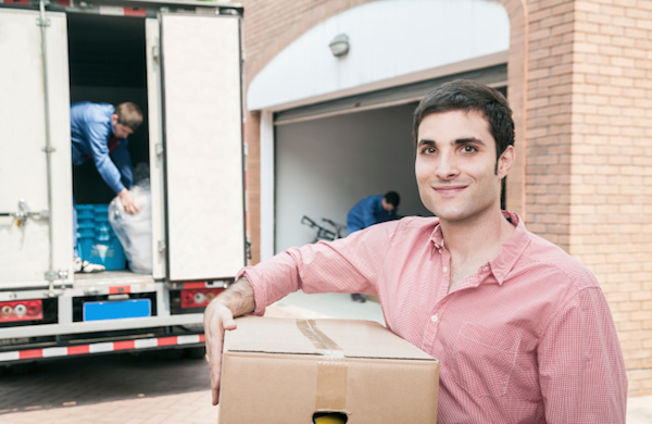 man with box near truck