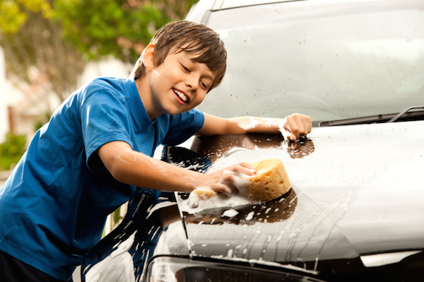 child washing car