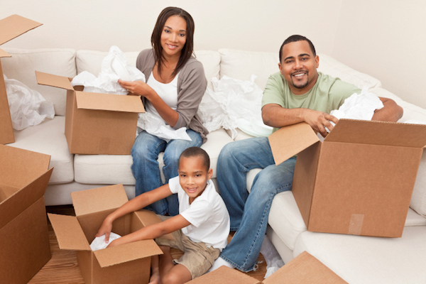 family unpacking on couch