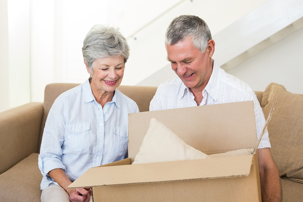 older couple with box