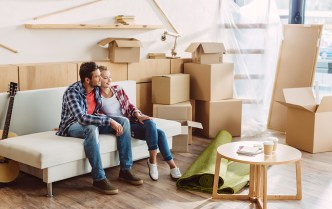 couple with boxes on couch