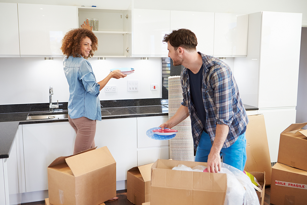 couple packing kitchen