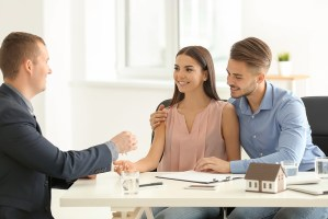couple completing mortgage agreement