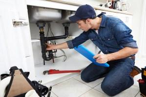 plumber repairing leak
