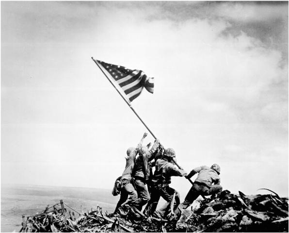 Raising the Flag on Iwo Jima, Joe Rosenthal's historic photo depicts five United States Marines and one sailor raising an American flag over Mount Suribachi during the Battle of Iwo Jima.The image above is an Associated Press photograph that won the Pulitzer Prize for Photography. It was taken by Joe Rosenthal on February 23, 1945. Photo: Joe Rosenthal/Associated Press