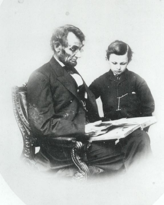 """A capacity and taste for reading gives access to whatever has already been discovered by others.""- Abraham Lincoln, shown here reading the Bible to his son, Tad"