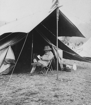 Theodore Roosevelt, enjoying the great outdoors with a book.