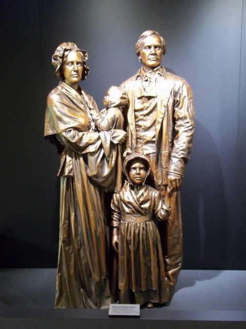 """Statue of the Lincoln family, with Mary Hanks Lincoln holding Abraham. In 1851, he was quoted as saying, Abraham said of his mother, """"God bless my mother; all that I am or ever hope to be I owe to her."""""""