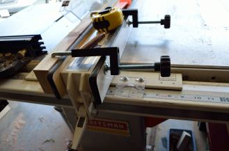 These clamps hold the auxilary fence onto the rip fence, and are far easier to use on this jig than the more generic adjustable clamps that can get in the way of the stock on its way to the blade..