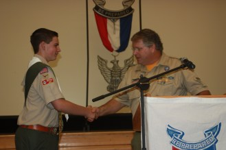 The Scoutmaster is generally one of the speakers and often presents the badge to the new Eagle.