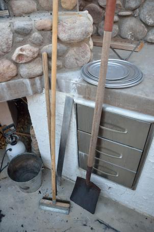 The cook's tools at the oven.