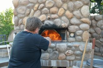 Move the coals to either side of the oven.