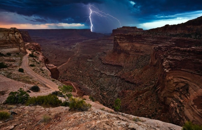 "Photograph by Ling Ling, who said, ""This shot was taken in the late afternoon of August 24, 2012, near Canyonlands National Park Island in the Sky Visitor's Center. There was a heavy rain in the north and the southeast area of the Park. I saw a windstorm coming out of the southeast - an immense cloud with flashing lightning."" Tweeted by the US Department of the Interior, 12/23/13."