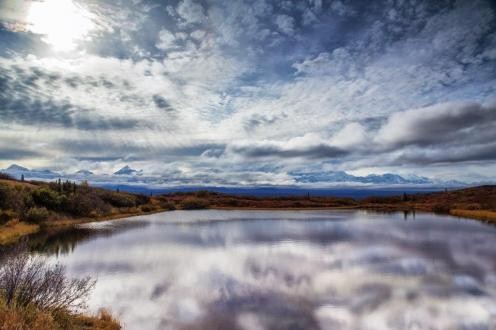 From the Park's website. Photo by: Courtesy Russell Blakeley Reflection Pond, near Wonder Lake and the western end of the Denali Park Road, is a particularly scenic spot.